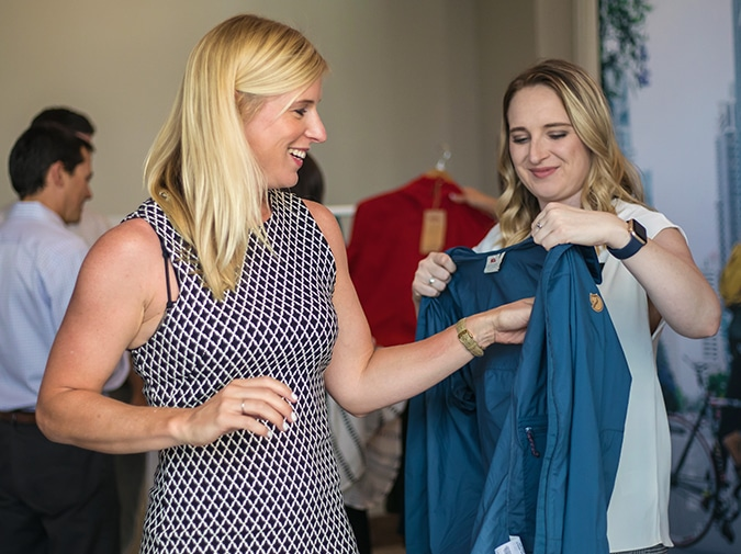 Diamond Level On-site Staff helps person try on