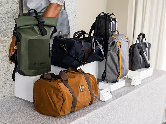Trendy backpacks duffles and work bags displayed for shopping